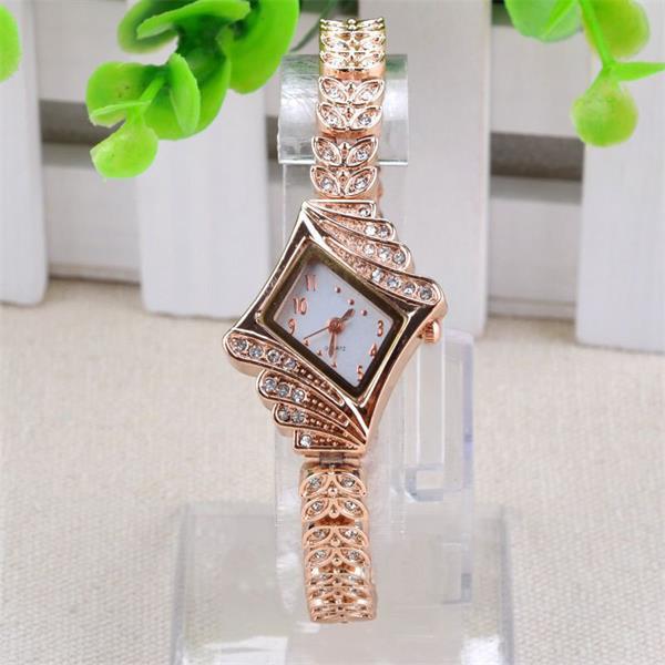 Frauen Gold überzogener Satz Schnecke Armband elegante Quarzuhr Uhren